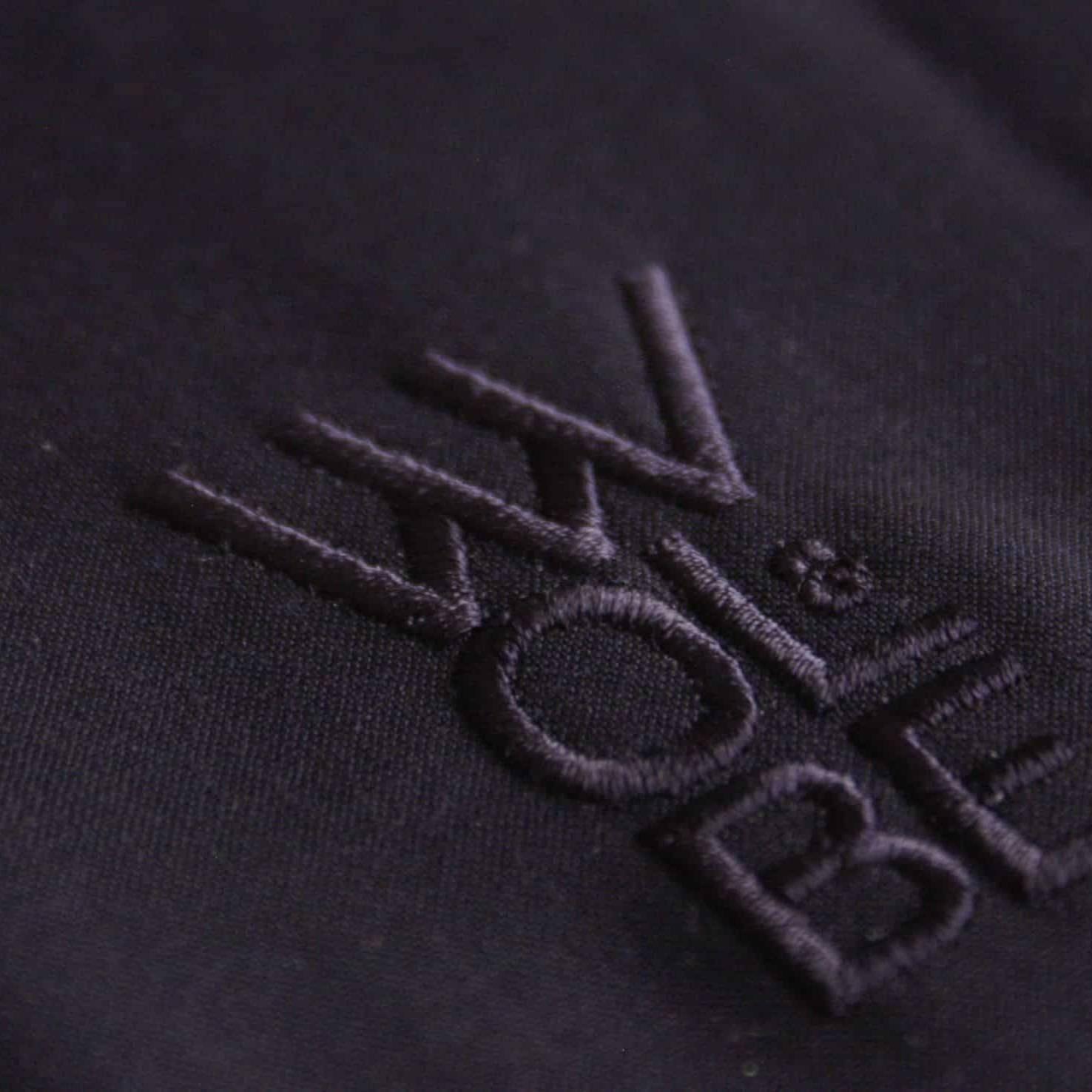 logo Wolbe brodé en bleu marine